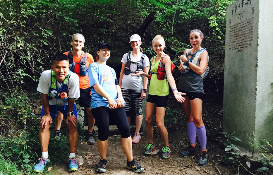 Members of Chasing Trails running group outside Hermit's Cave.