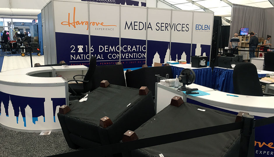 Media services tent photo —several chairs are overturned