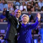 President Barack Obama and Democratic Presidential candidate Hillary Clinton wave together during the third day of the Democratic National Convention in Philadelphia , Wednesday, July 27, 2016.
