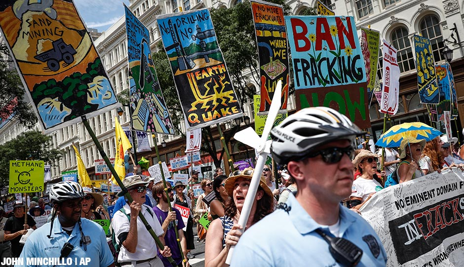 Supporters of Sen. Bernie Sanders, I-Vt., march alongside Philadelphia police during a protest on Sunday, July 24.