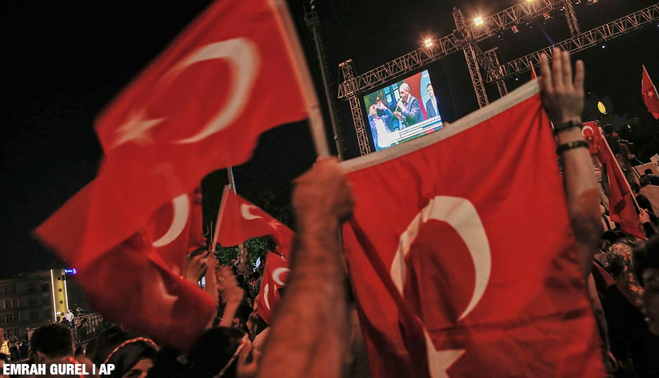 People gathered in Taksim Square in Istanbul to protest against the attempted coup, watch a pre-recorded video message by Turkish President Recep Tayyip Erdogan, early Tuesday, July 19, 2016.