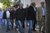 At right is John Dougherty, business manager of Local 98 International Brotherhood of Electrical Workers along with Michael Barnes, head of the Stagehands Local 8, walk with members of Teamsters Local 107  on Monday, May 12, 2014, in Philadelphia. Teamsters Local 107 are protesting an alleged lockout by management at the convention center on Monday morning. (AP Photo/The Philadelphia Inquirer, Alejandro A. Alvarez)  PHIX OUT; TV OUT; MAGS OUT; NEWARK OUT