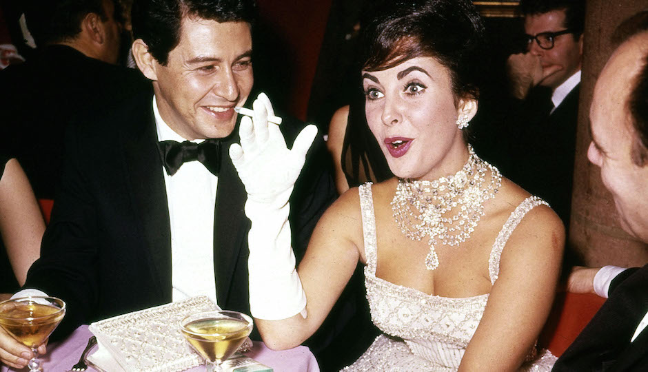 British actress Elizabeth Taylor jokes with husband Eddie Fisher during a party at Leone's restaurant in New York City, Nov. 1959. Exact date unknown. (AP Photo)