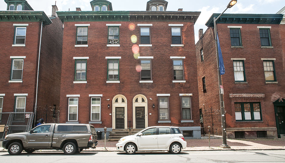 Rowhomes on Chestnut Street in West Philly. | Photograph by Claudia Gavin