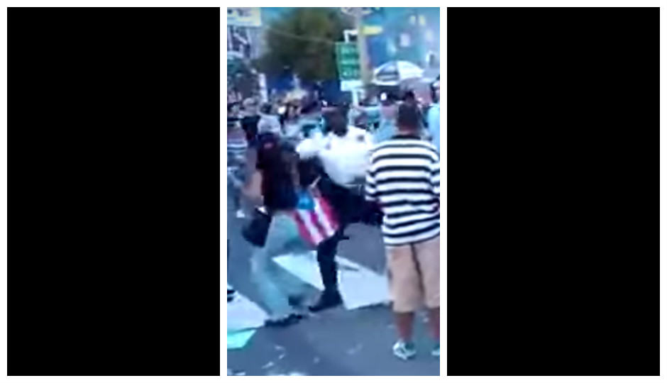 Philly Police Lt. Jonathan Josey (center) in infamous video clip of his encounter with a woman at the Puerto Rican Day Parade in 2012.