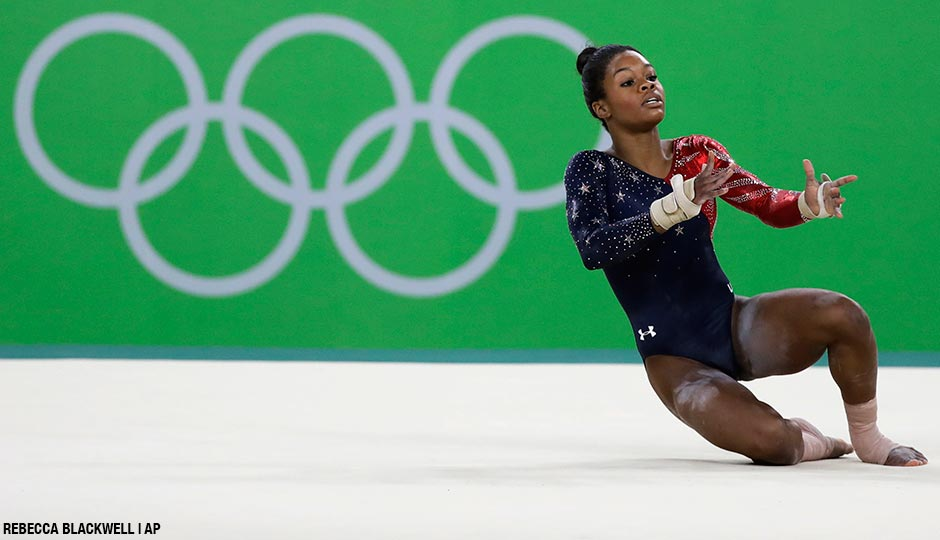 "Gabrielle ""Gabby"" Douglas performs on the floor during the artistic gymnastics women's qualification at the 2016 Summer Olympics in Rio de Janeiro, Brazil."
