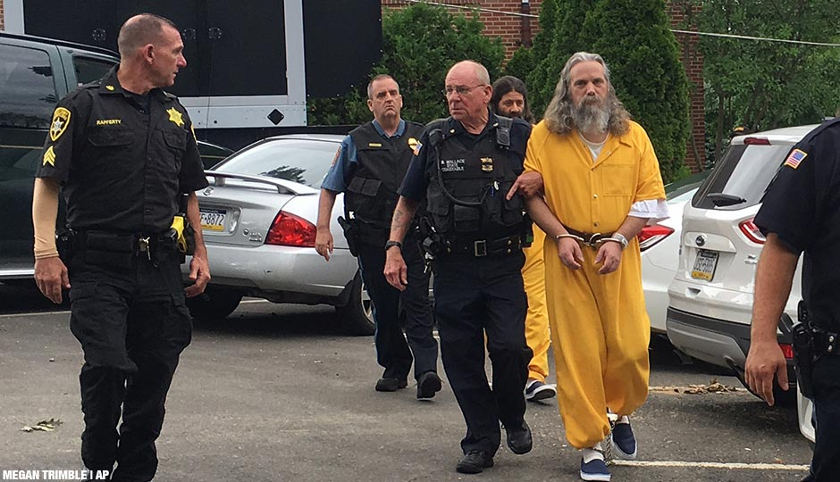 Lee Kaplan, front in yellow, and Daniel Stoltzfus, back in yellow, are led to a preliminary hearing Tuesday, Aug. 2, 2016, outside Bucks County Magisterial District Judge John I. Waltman's courtroom in Feasterville, Pa. Daniel Stoltzfus and his wife Savilla Stoltzfus were ordered to stand trial on charges they gave away their 14-year-old daughter to a Philadelphia-area man after he helped them out financially.