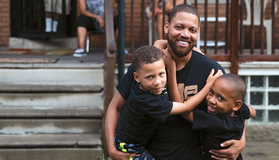 Otis Bullock Jr. with his sons Xavier, 5, and Malcolm, 8.   Photograph by Neal Santos