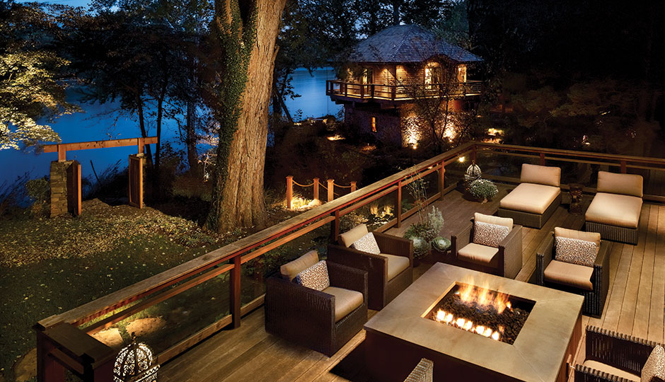 The deck disguises the elevated foundation while providing a woodsy perch for taking in views of the river.