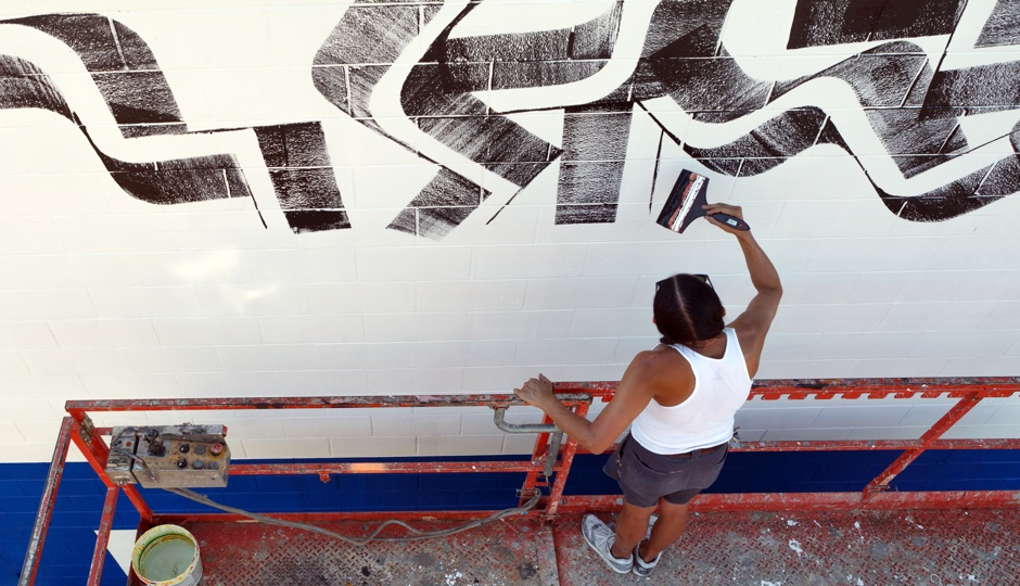 Artist Isaac Lin creating a new piece of public art at the Murals at Swanson Walk, South Philadelphia. Photo by Steve Weinik for Mural Arts Philadelphia