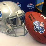 A grey NFL Draft helmet and a football