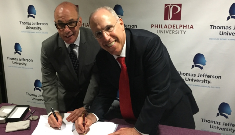 Dr. Stephen Klasko, President & CEO of Thomas Jefferson University and Jefferson Health, and Dr. Stephen Spinelli, PhilaU President, sign the binding combination agreement to bring the two institutions together as one, comprehensive university in 2017.