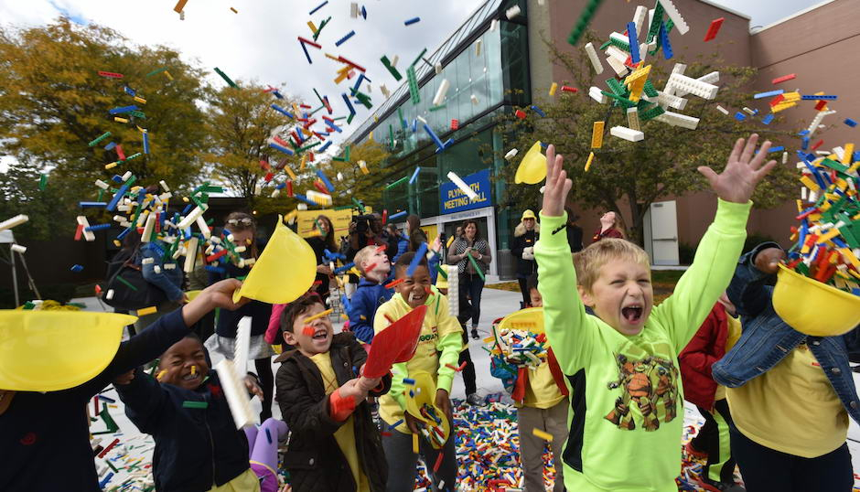 Plymouth Elementary School first grade students celebrate the groundbreaking of the new Legoland Discovery Center at Plymouth Meeting Mall by playing in a pile of more than 50,000 Lego bricks spilled by a dump truck at the Oct. 25 ceremony. | Photo courtesy Legoland Discovery Center