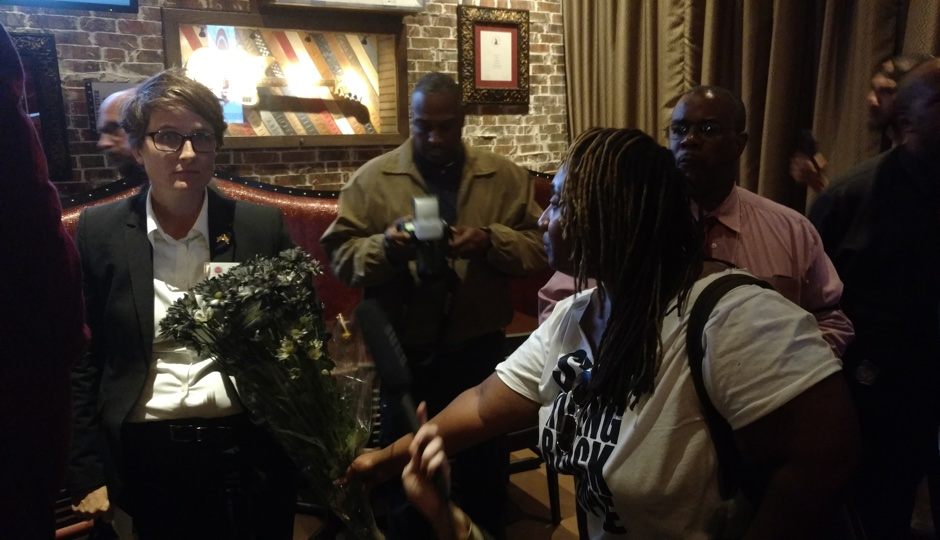 "Nellie Fitzpatrick being offered ""anti-blackness"" flowers by protesters on October 5th. Photo by Ernest Owens."