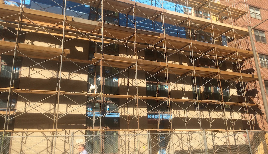 Scaffolding surrounds the Walnut Street townhouse in Van Pelt Mews in September.   Photos: Sandy Smith