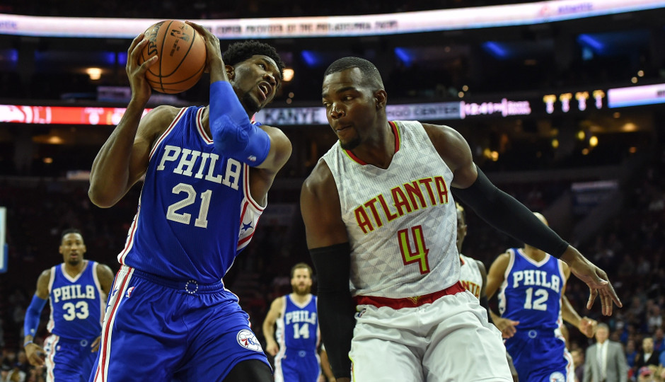 Joel Embiid (14 points) works against Paul Millsap (17 points) in the first quarter of the Sixers 104-72 loss to the Hawks | John Geliebter-USA TODAY Sports