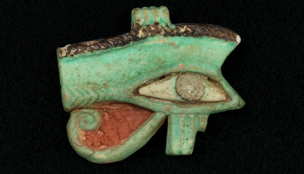 """The wedjat, or Eye of Horus, was a popular protective amulet in Egypt. We derive our symbol for prescription, """"Rx,"""" from it. This object is one of 81 magical objects featured in Magic in the Ancient World, a new exhibition at the Penn Museum. Photo courtesy of the Penn Museum"""