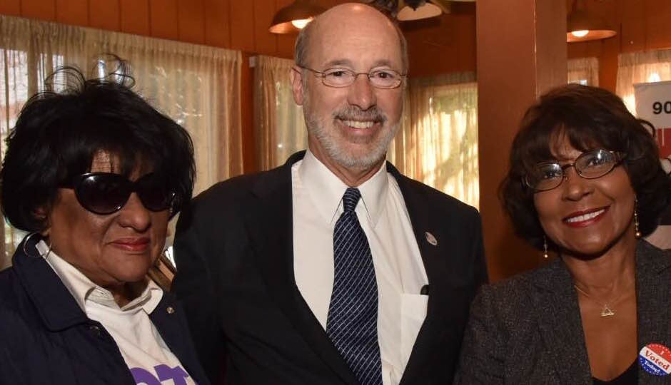 City Councilwomen Jannie Blackwell (left) and Blondell Reynolds Brown (right) flank Gov. Tom Wolf. (Photo: HughE Dillon