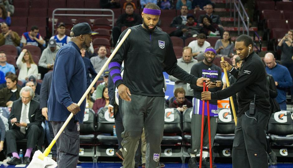 Kings center DeMarcus Cousins helps mop the Wells Fargo Center floor | Bill Streicher-USA TODAY Sports