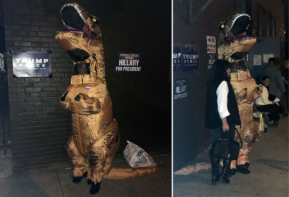 Shaunna Van Elsis, dressed in a dinosaur costume, waits outside after she voted