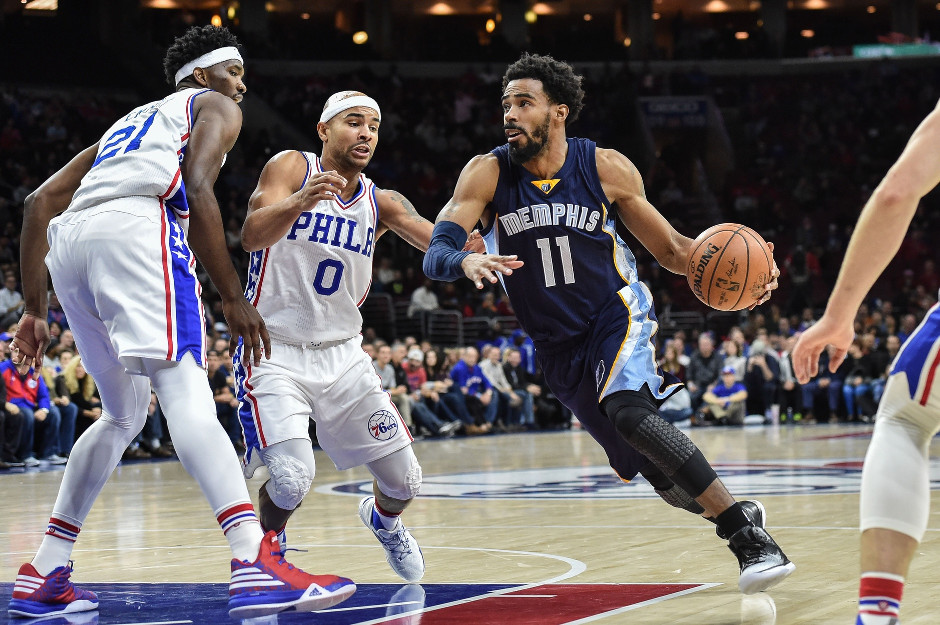 Joel Embiid (21) and Jerryd Bayless (0) defend Mike Conley of the Memphis Grizzlies during the Grizzlies 104-99 double overtime victory | John Geliebter-USA TODAY Sports