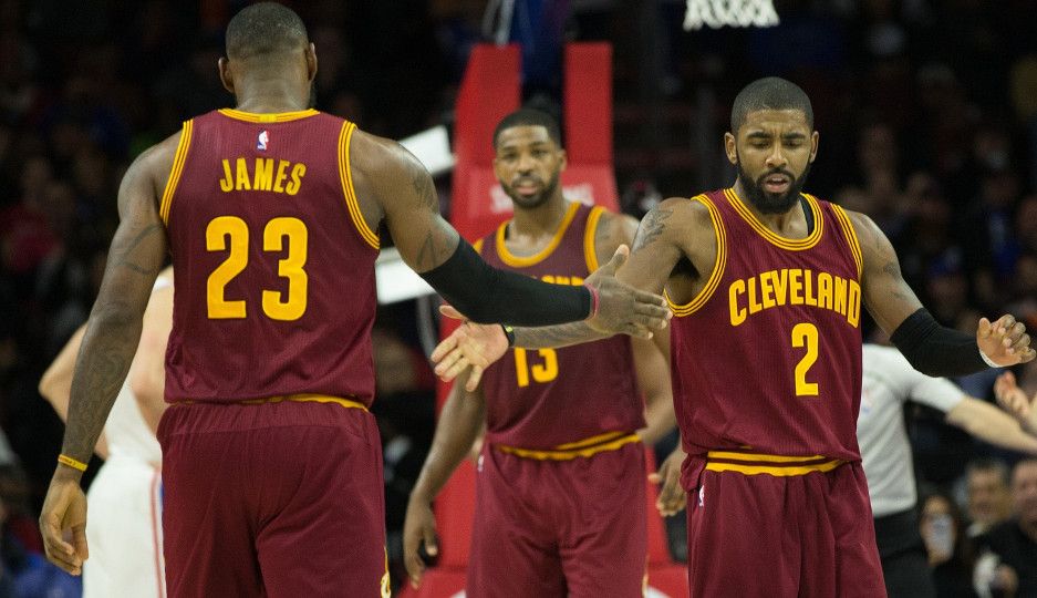 LeBron James (left) and Kyrie Irving (right) react after a basket in the second quarter of Cleveland's 112-108 victory | Bill Streicher-USA TODAY Sports