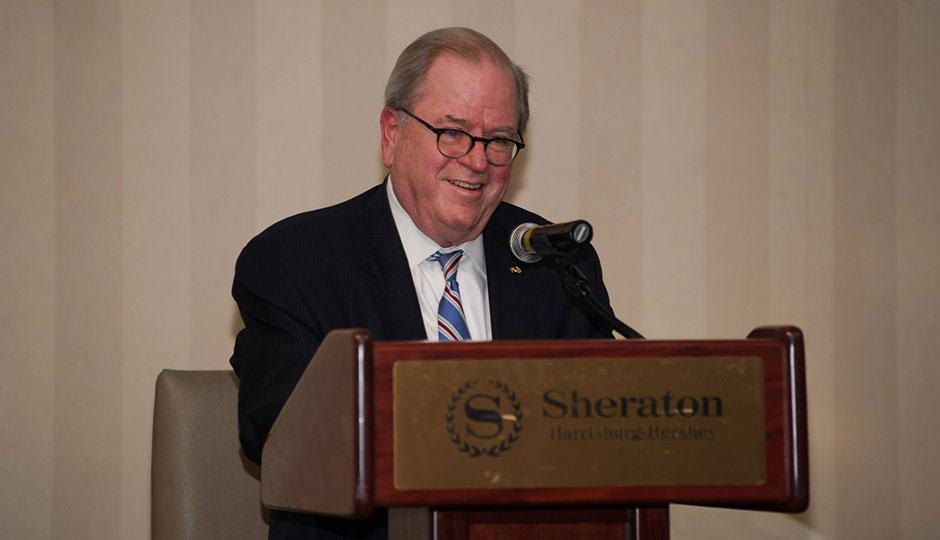 Ron Castille speaking at a podium