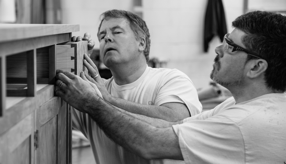Eric Corkhill of Philadelphia (left) participated in the Thos. Moser Customer in Residence program last year as a gift from his wife. Here he works on his furniture with Moser craftsman Bob Fisher. | Photo: Courtesy Thos. Moser