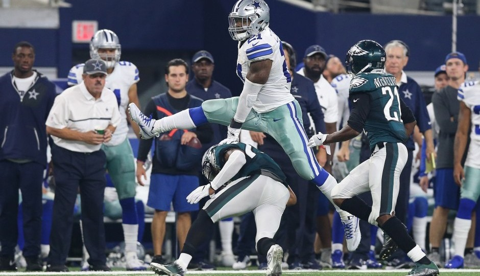 Ezekiel Elliott leaps over Malcolm Jenkins. (USA Today Sports)