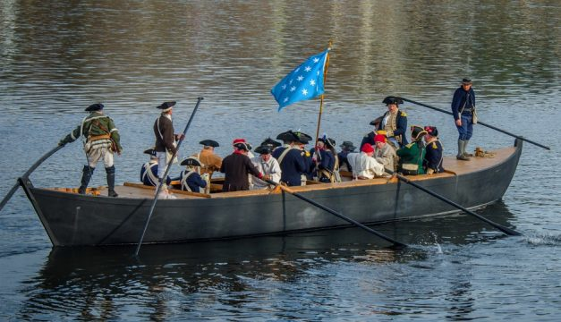 History buffs get into the spirit of the season when they witness Washington Crossing the Delaware River, a re-enactment staged at Washington Crossing Historic Park on Christmas Day. Photo by R. Kennedy for Visit Philadelphia