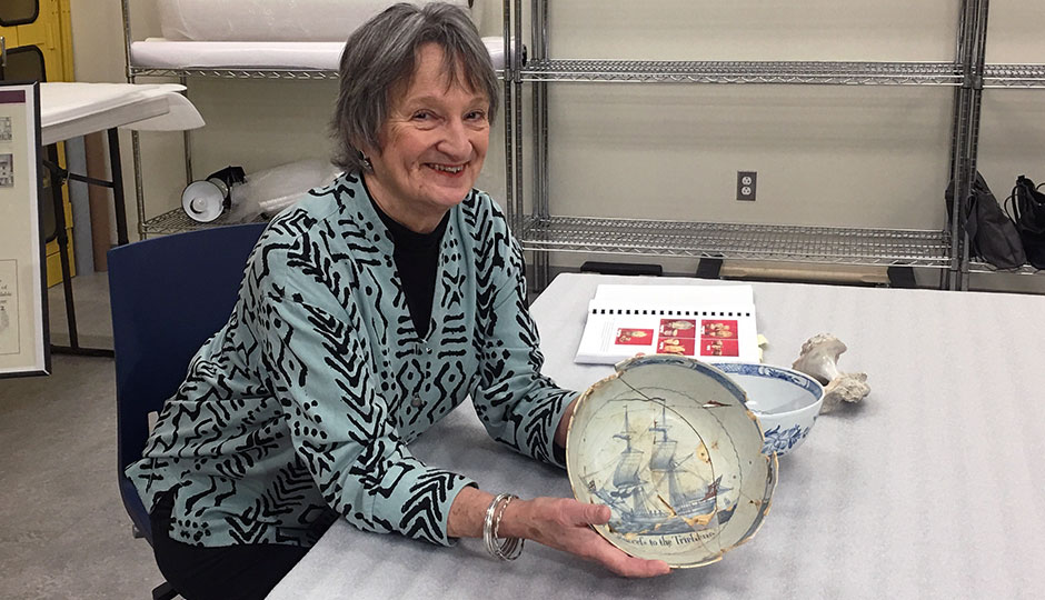 Rebecca Yamin displays blue and white bowl from the 1760s