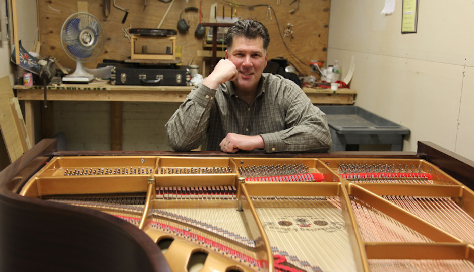 Cunningham Piano co-owner Rich Galassini in the company's Germantown restoration facility.