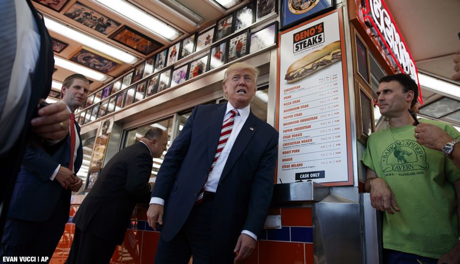 Republican presidential candidate Donald Trump talks with customers during a visit to Geno's Steaks, Thursday, Sept. 22, 2016, in Philadelphia | AP Photo/ Evan Vucci