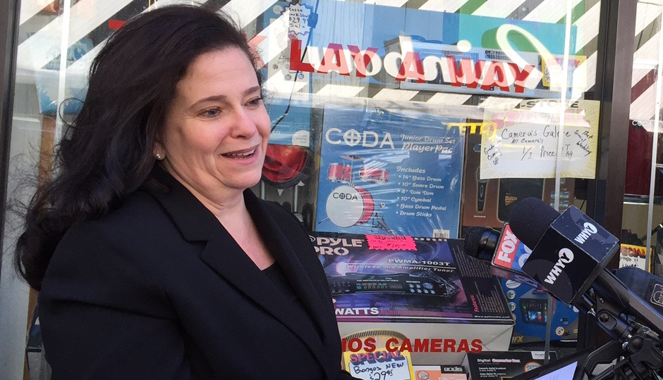 Former city prosecutor Beth Grossman announces her candidacy in front of a Kensington pawn shop where her family once owned a candy store.
