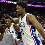 Sixers center Joel Embiid congratulates Robert Covington, mid-interview, for his game winning basket |  John Geliebter-USA TODAY Sports
