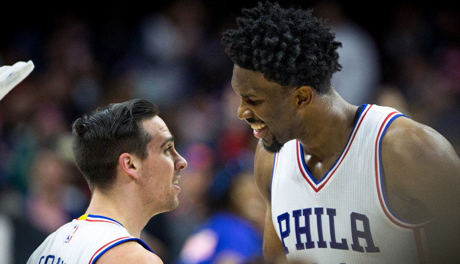 Sixers center Joel Embiid celebrates with T.J. McConnell after McConnell's game-winning shot gave the Sixers a 98-98 victory | Bill Streicher-USA TODAY Sports