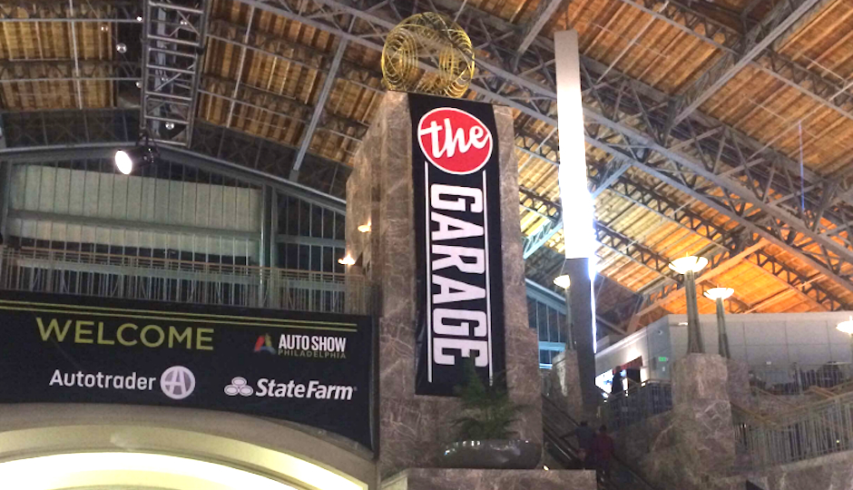 "A photo of signage for ""The Garage"" bar at last year's Philadelphia Auto Show. (Court exhibit)"