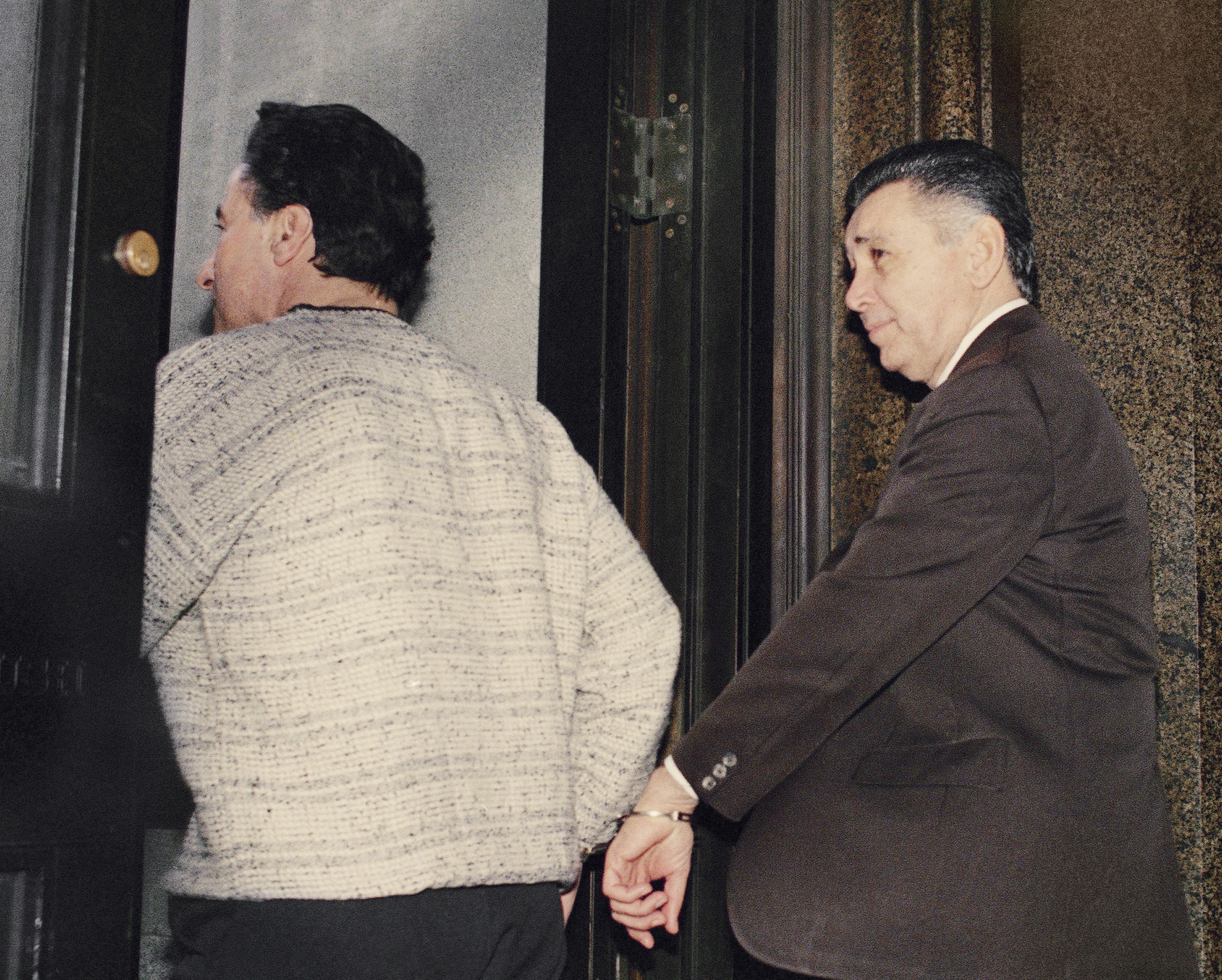 """Reputed crime boss Nicodemo """"Little Nicky"""" Scarfo is led from Philadelphia Common Pleas Court, April 6, 1989, after being sentenced to life in prison along with seven of his associates. The prosecution was seeking the death penalty, but Judge Eugene Clarke announced his decision in the 1985 murder case of gangster Frank D'Alfonso which Scarfo and his associates were found guilty. (AP Photo/Charles Krupa)"""
