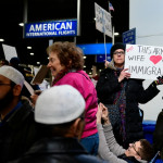 Johanna Noonan, of Philadelphia, holds up a sign during a protest of President Donald Trump's executive order banning travel to the U.S. by citizens of several countries Sunday, January 29th, 2017, at Philadelphia International Airport in Philadelphia. (AP Photo/Corey Perrine)
