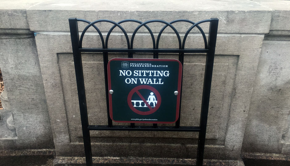 ban on Wall sitting at rittenhouse sign