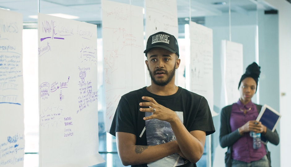 Sudan Green explains his group's ideas to the class during January's session.
