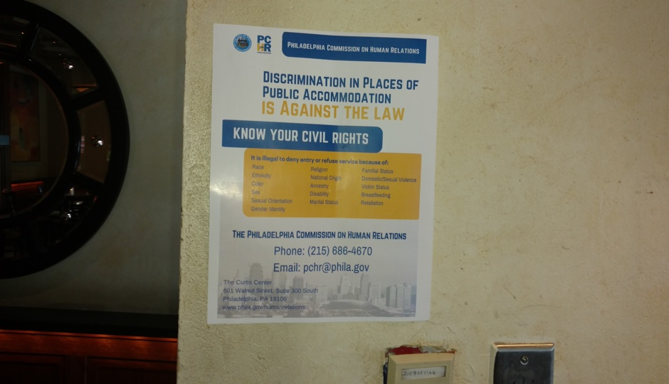 Poster detailing the Fair Practices Ordinance now visible at Knock bar in Gayborhood | Photo credit: Ernest Owens