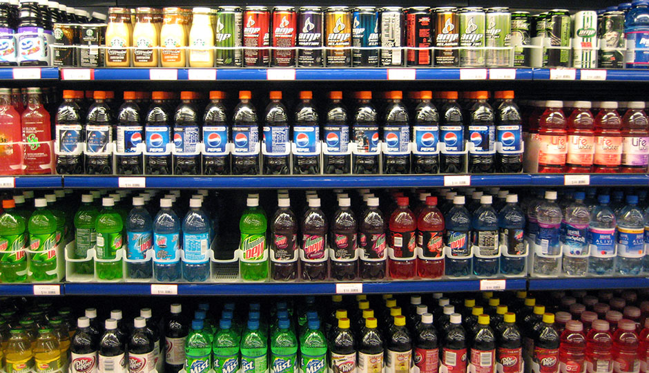 Sodas for sale in a refrigerated case