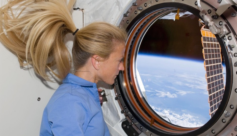 S124-E-008613 (10 June 2008) --- Astronaut Karen Nyberg, STS-124 mission specialist, looks through a window in the newly installed Kibo laboratory of the International Space Station while Space Shuttle Discovery is docked with the station.