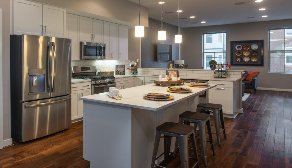 The open floor plan kitchen is completely modern.