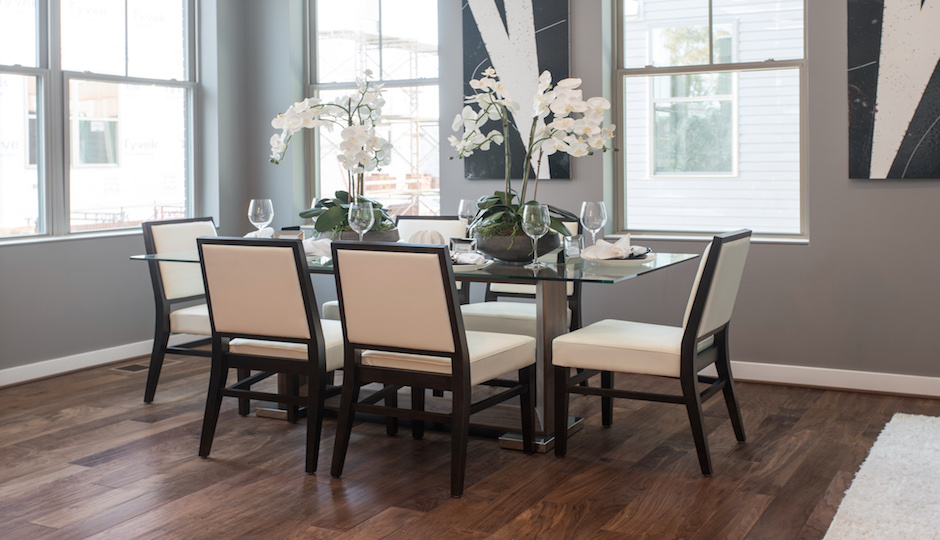 A staged dining room in a completed unit.