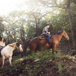 At Travaasa, guests can try their hand at horseback riding. Photo via istockphoto