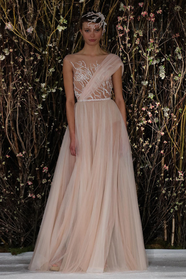 NEW YORK, NY - APRIL 15: A model walks the runway wearing the Mira Zwilliner Bridal Collection Spring 2017 on April 15, 2016 in New York City.