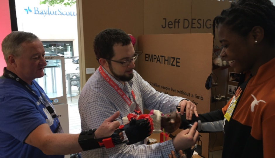 Mayor Kenney at the 2017 SXSW Social Hub testing Jefferson University's 3D printed hands.
