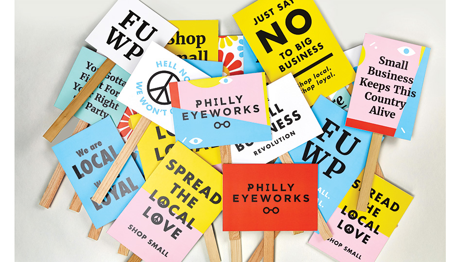 Philly EyeWorks airs its grievances with groovy picket signs. Photo by Andrew Bonacci.